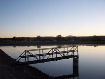 Catwalk over lagoon. Golden Sunrise over the lagoon of Bonanza Oregon Stock Images