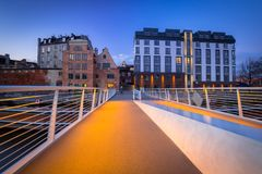 Catwalk over Motlawa river in Gdansk at dusk. Poland Royalty Free Stock Images