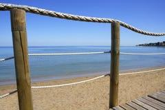 Catwalk on wood rope railing on sea beach Stock Images