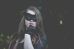 Catwoman одетый девушкой Стоковые Изображения RF
