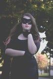 Catwoman одетый девушкой Стоковое Изображение