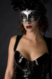 Catwoman Carnival. Beautiful young woman wearing a latex catsuit and mask Royalty Free Stock Photos