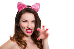 Catwoman make-up on attractive hot model. Pink lipstick, nailpolish isolated on white stock images