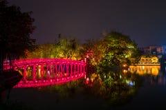 The Cau The Huc red bridge in Hanoi, Vietnam. stock photos