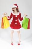 Caucásico sonriente feliz Santa Girl en dos mentes con el un montón de C foto de archivo libre de regalías