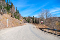 Caucas Mountains. Bend in the road with roadsign Royalty Free Stock Photography
