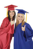 Caucasain Girls Wearing Gratuation Gowns Giving The Thumbs Up Sign Royalty Free Stock Image