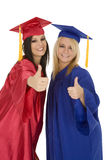 Caucasain Girls Wearing Gratuation Gowns Giving The Thumbs Up Sign Stock Photography