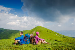 Caucasian active couple enjoying the view. On their hiking trip stock images