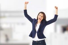 Skrika för kvinna för framgångyong affär fira royaltyfri foto