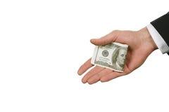 Caucasian affärsmans hand med pengar Royaltyfria Bilder