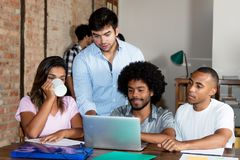 Caucasian and african american business team of young people. At modern office of start up enterprise royalty free stock image