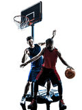 Caucasian and african basketball players man dribbling silhouett. Two men basketball players competition dribbling in silhouette isolated white background Royalty Free Stock Images