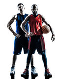 Caucasian and african basketball players man silhouette. Two men basketball players holding ball in silhouette isolated white background Royalty Free Stock Image