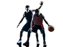 Caucasian and african basketball players man. Two men basketball players competition in silhouette isolated white background Royalty Free Stock Images