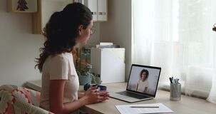 Caucasian and african women talking by video conference call