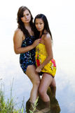 Caucasian And Asian American Women Standing In River Royalty Free Stock Images
