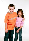Caucasian and asian kids Stock Photos