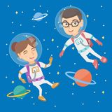 Caucasian astronaut kids in suits flying in space. Caucasian astronaut kids wearing space suits and flying in space with planets. Children taking part in space Stock Photos