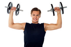 Caucasian athlete exercising in sporty outfits Stock Photos