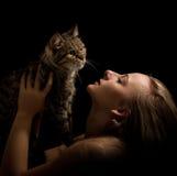 Caucasian attractivefashion model posing in studio. Holding cat stock image