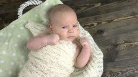 Caucasian baby, basket with bow. stock footage