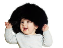 Caucasian baby boy in big black hat isolated Stock Image