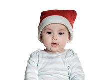 Caucasian baby boy in Christmas hat Royalty Free Stock Images