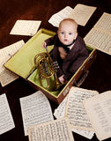 Caucasian baby boy plays with trumpet Royalty Free Stock Images