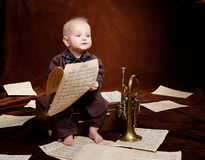 Caucasian baby boy plays with trumpet Royalty Free Stock Photography