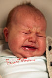 Caucasian baby crying stock images