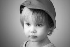 Caucasian baby girl in big baseball cap Stock Photos
