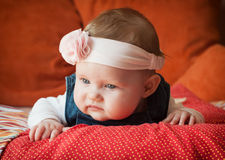 Caucasian baby girl lying on her stomach Royalty Free Stock Photo