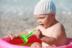 Caucasian baby playing on the beach Royalty Free Stock Photography