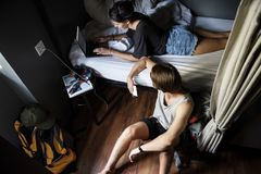 Caucasian backpackers in hostel shared bed room royalty free stock photos