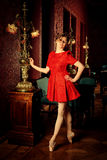 Caucasian ballerina för mode i röd klänning royaltyfria foton