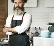 Caucasian barista man at coffee shop stock photo
