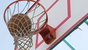 Caucasian basketball player making hook shot in basket and getting extra points