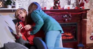 Caucasian beautiful woman lying on sofa on christmas day stock video footage