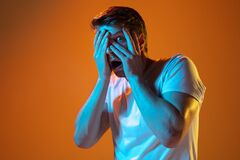 Free Caucasian Beautiful Young Man`s Portrait On Gradient Orange Studio Background, Emotional And Expressive. Copyspace For Royalty Free Stock Photography - 189216177