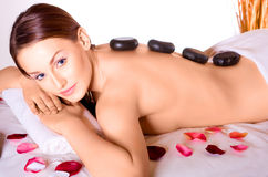 Caucasian beauty in the spa salon whith stones Stock Photo