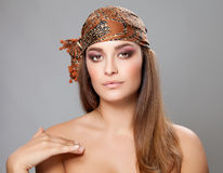 Caucasian beauty wearing a headscarf Stock Photos