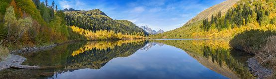Caucasian Biosphere Reserve. Autumn reflection on the lake Kardyvach. Russia. Lake Kardyvach is the mirror heart of the Caucasian Biosphere Reserve stock image