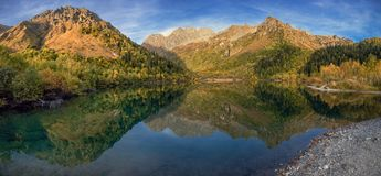 Caucasian Biosphere Reserve. Evening at Lake Kardyvach. Lake Kardyvach is the mirror heart of the Caucasian Biosphere Reserve stock images