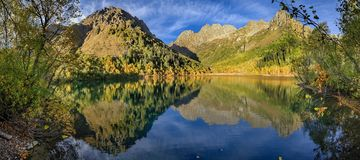Caucasian Biosphere Reserve. Lake Kardyvach in the autumn evening. Lake Kardyvach is the mirror heart of the Caucasian Biosphere Reserve stock images