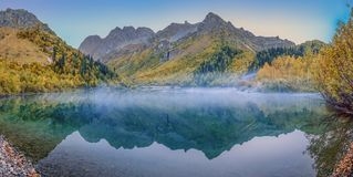Caucasian Biosphere Reserve. Morning mist on the Kardyvach lake. Lake Kardyvach is the mirror heart of the Caucasian Biosphere Reserve stock photos