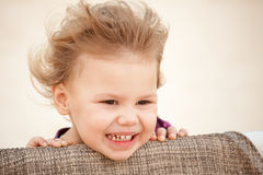 Caucasian blond baby girl with wind in her hair Royalty Free Stock Photos