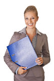 Caucasian blond businesswoman in suit holding ring Stock Photography