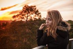 Caucasian blond girl with evening sunlight Stock Photos