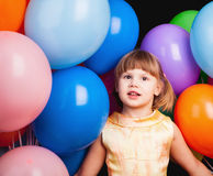 Caucasian blond little girl with colorful balloons Stock Photo